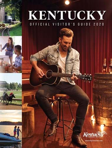 The cover of the 2020 Kentucky official visitors guide, showing J.D. Shelburne playing his guitar