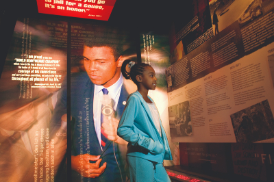 A young girl looks at an exhibit at the Muhammad Ali Center in Louisville, Kentucky