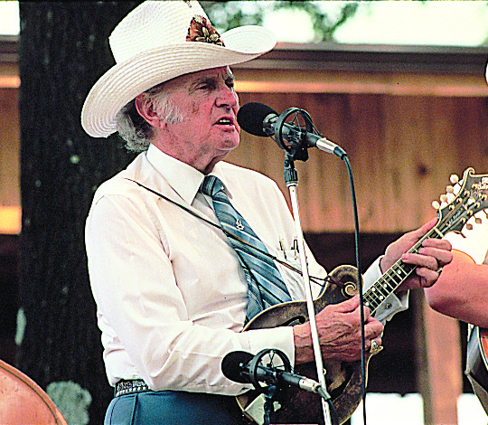 An archival image of Bill Monroe performing