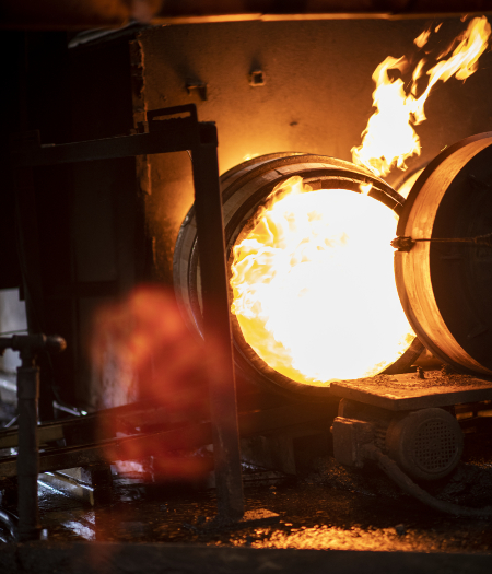 A bourbon barrel is charred at a Kentucky cooperage