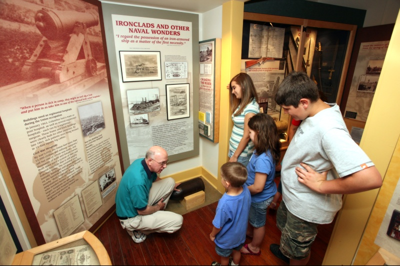 Kids interact with an exhibit at Columbus-Belmont State Park Civil War Museum