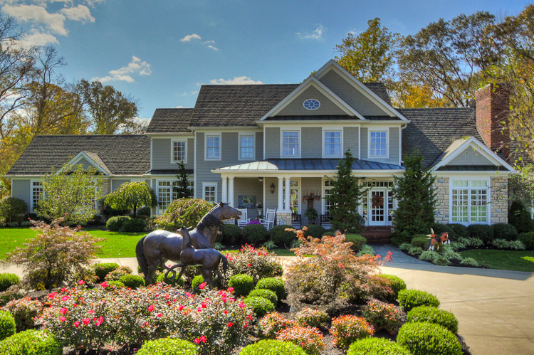 Exterior shot of Bluegrass Country Estate B&B with horse statue and driveway