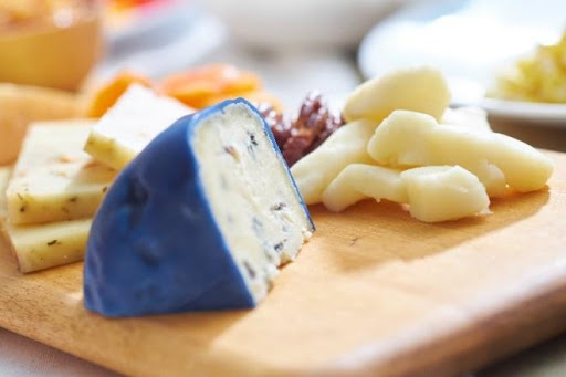 A cheese board featuring cheeses from Kentucky's Caves, Lakes & Corvettes region