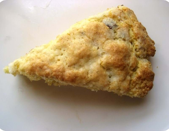 An overhead shot of an Elmwood Scone on a white surface