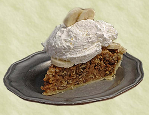 A heaping slice of Patti's Sawdust Pie topped with whipped cream