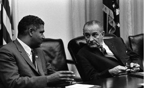 Civil Rights leader Whitney M. Young talks with President Lyndon Johnson in an archival photo