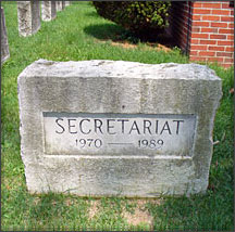 A headstone marks Secretariat's final resting place at Claiborne Farm in Paris, KY