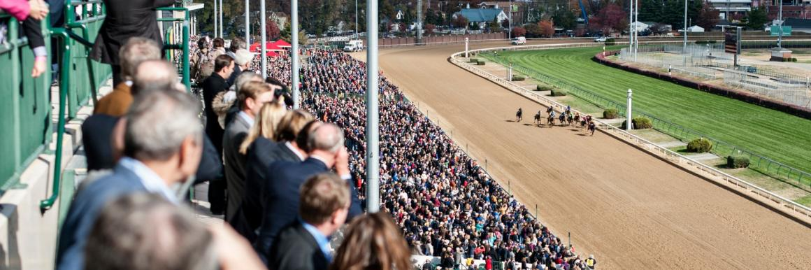 A crowd of people watch the Kentucky Derby at Churchill Downs in Louisville, KY