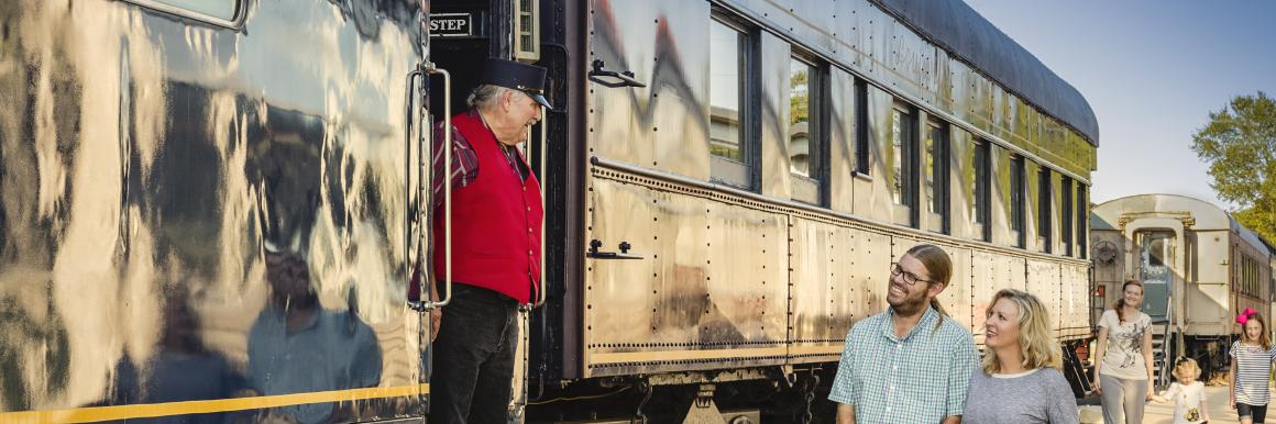 Couple talking to conductor at Historic RailPark & Train Museum