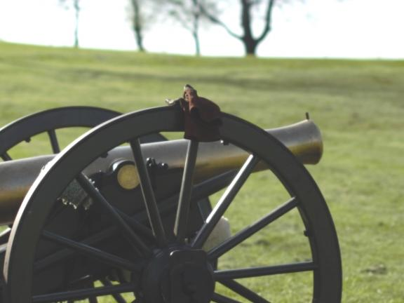 Two Civil War reenactors work a cannon on a Kentucky battlefield