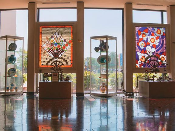 "An interior shot of the National Quilt Museum in Paducah, Kentucky, with stained glass ""quilt"" windows"