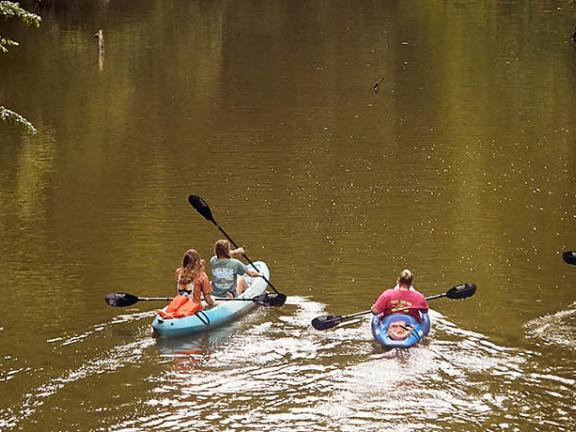 A family paddles a Kentucky waterway