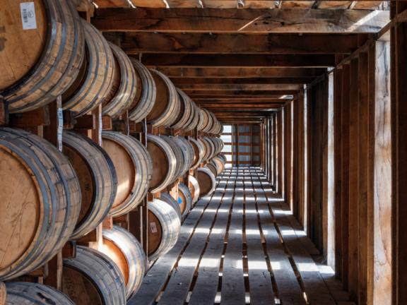 Rows of bourbon barrels inside a warehouse at Barton distillery