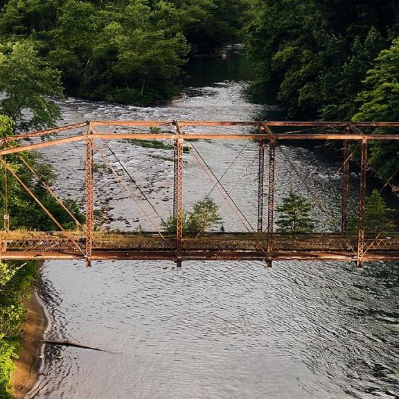 A historic bridge spans a river in Kentucky