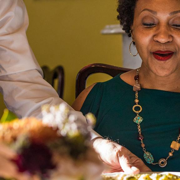 A woman is served a plate of food at Kentucky's Holly Hill Inn