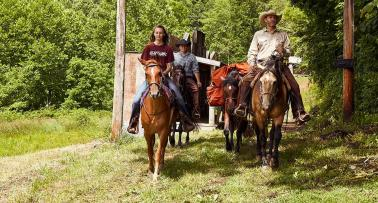 Horseback riders follow a trail in the Kentucky Trail Town of McKee