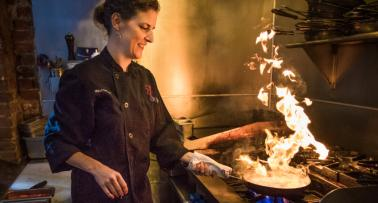 Chef Molly Costello cooks with fire in the kitchen of her restaurant, Otto's