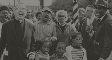 Marchers, including Martin Luther King, Jr., walk in a Civil Rights demonstration
