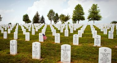 Rows of headstones sprawl across a hill at Camp Nelson National Cemetery