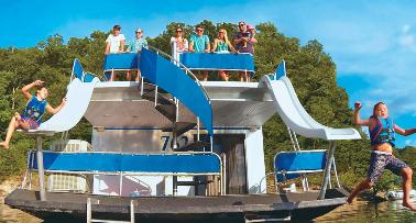 Two boys splash into Lake Cumberland off a houseboat double waterslide