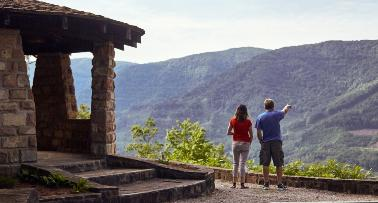 A couple looks out at a scenic mountain view at a Kentucky State Park
