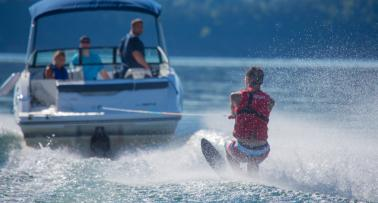 A boat tows a water skiier on a Kentucky lake
