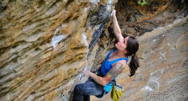 A woman goes rock climbing in Kentucky