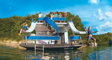 Two young boys slide down double waterslides on a houseboat in Kentucky