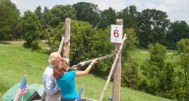 A man and a woman go target shooting in Kentucky