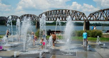 Kids play in the water at a splash park on the riverfront in Owensboro, KY