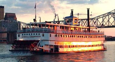 The Belle of Louisville riverboat sails into the sunset on the Ohio River