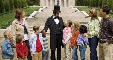 A group of people stands around an Abraham Lincoln reenactor in Kentucky