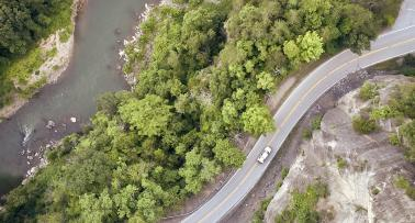 Overhead shot of a car traveling on a Kentucky highway