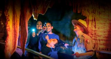 A family tours Mammoth Cave with flashlights