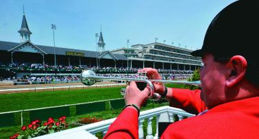A bugler in a red jacket at the Kentucky Derby