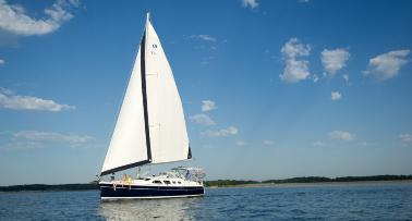 A sailboat sails on Lake Barkley in Kentucky's Western Waterlands