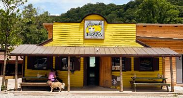 Exterior shot of Miguel's Pizza in Slade, Kentucky, a certified Trail Town