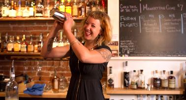 A bartender shakes up a cocktail at a bar on the B-Line bourbon trail