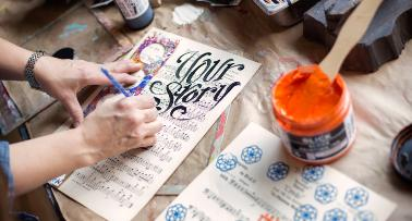 A Kentucky artist works on a piece of hand lettering