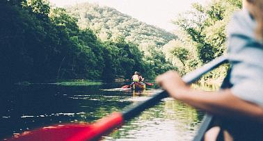 Kayakers paddle along the Big South Fork River in Kentucky