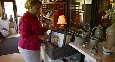 Lady shopping at Tater Knob Pottery