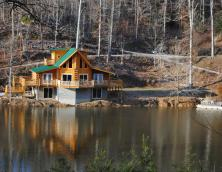 A Sleepy Bear's Dream, shown above, sleeps 7 and is the largest of the three cabins. It's all about the porches and views from this picturesque spot. Photo
