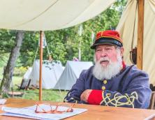 A Civil War Officer sitting in the camp at Battle of Middle Creek Reenactment. Photo