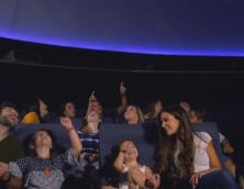 A group of people enjoying a planetarium show at East Kentucky Science Center & Planetarium. Photo