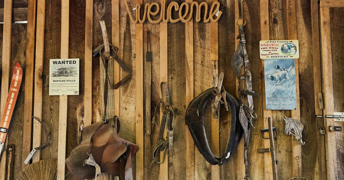 A Hatfield & McCoy display hangs on a wall