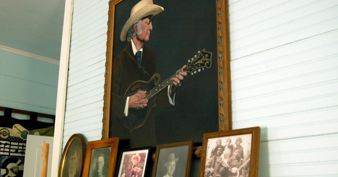 An exhibit displays historic photos of Bill Monroe