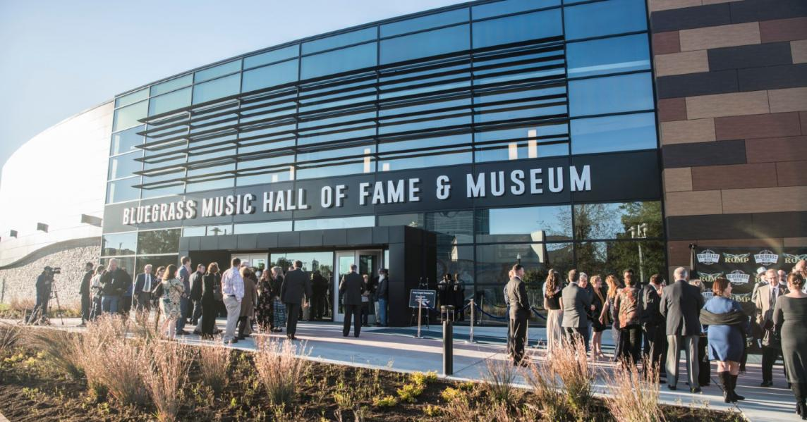 The sun reflects off the glass exterior of the Bluegrass Music Hall of Fame & Museum