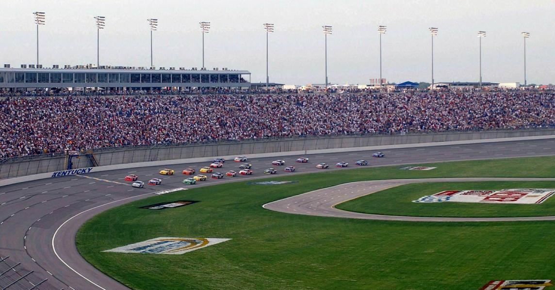 Race cars round the bend at Kentucky Speedway