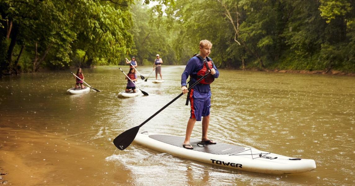 A family goes paddleboarding on a Kentucky river
