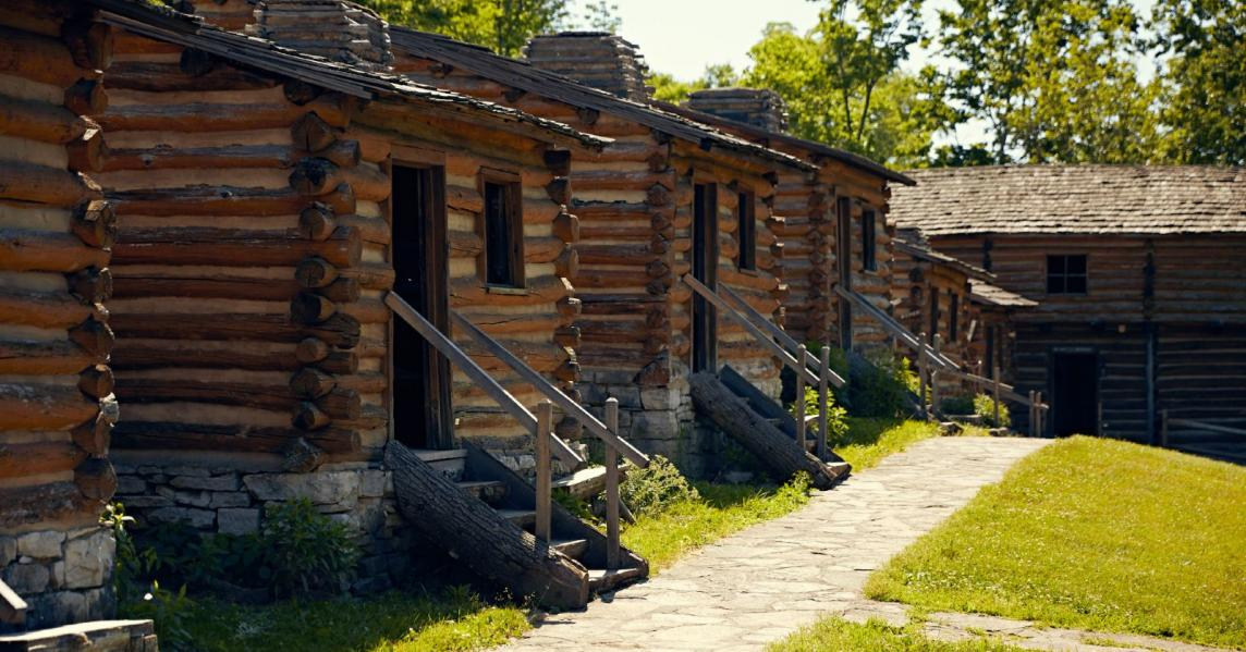 Rows of log structures at Old Fort Harrod State Park